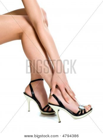 Beautiful Legs In Black Shoes Isolated On White Background