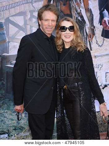 LOS ANGELES - JUN 22:  Jerry Bruckheimer & wife Linda arrives to the 'The Lone Ranger' Hollywood Premiere  on June 22, 2013 in Hollywood, CA