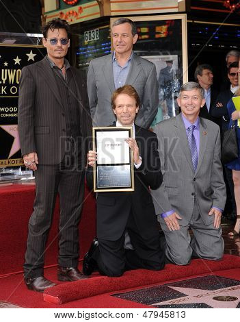 LOS ANGELES - JUN 23:  Johnny Depp, Jerry Bruckheimer, Robert Iger & LeRon Gubler arrives to the Walk of Fame Honors Jerry Bruckheimer  on June 23, 2013 in Hollywood, CA