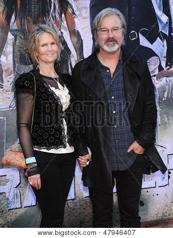 LOS ANGELES - JUN 22:  Gore Verbinski & wife Clayton arrives to the 'The Lone Ranger' Hollywood Premiere  on June 22, 2013 in Hollywood, CA