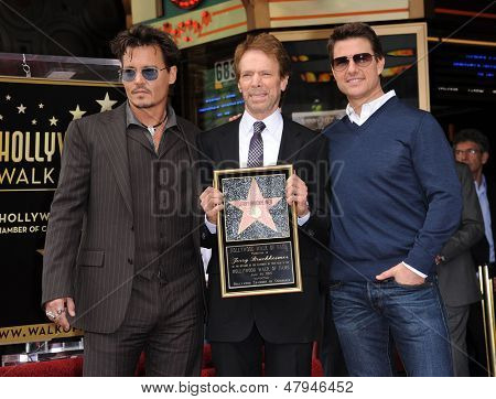 LOS ANGELES - JUN 23:  Johnny Depp, Jerry Bruckheimer &Tom Cruise arrives to the Walk of Fame Honors Jerry Bruckheimer  on June 23, 2013 in Hollywood, CA