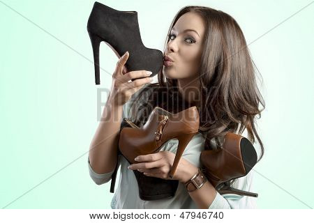 Funny Girl Holding Many Shoes