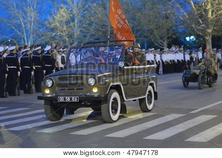 SEVASTOPOL, UKRAINE - MAY 7: Car with the flag on the rehearsal of military parade in honor of Victory Day in Sevastopol, Crimea, Ukraine on May 7, 2013