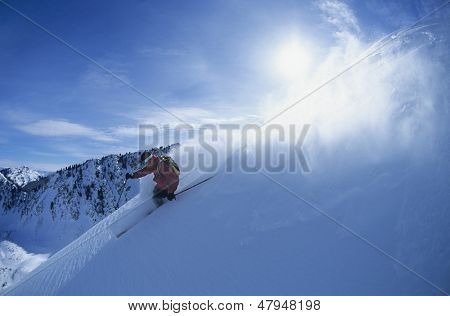Man skiing on mountain slope