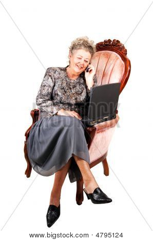 Business Woman In Armchair.