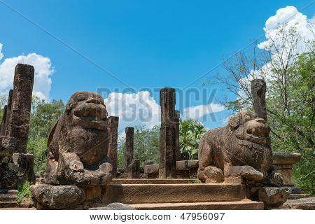 Ancient Lion Guards Near Entrance