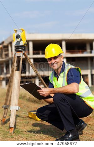 senior land surveyor at work