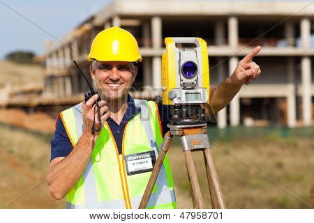 land surveyor speaking on walkie talkie