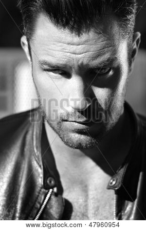 Classic black and white fine art portrait of a handsome tough guy