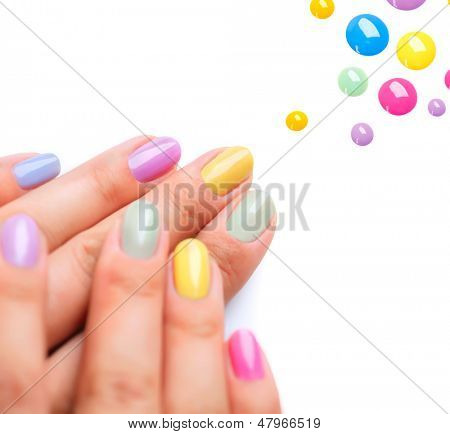 Nail Polish. Art Manicure. Multi-colored Nail Polish. Beauty hands. Stylish Colorful Nails