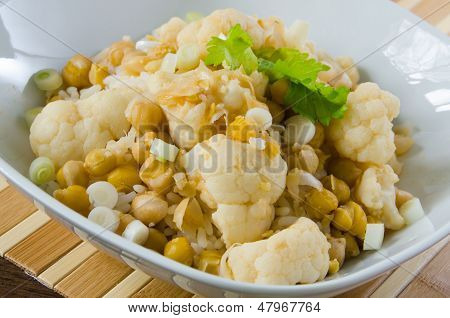 Vegetables curry with cauliflower, chickpeas and spring onions