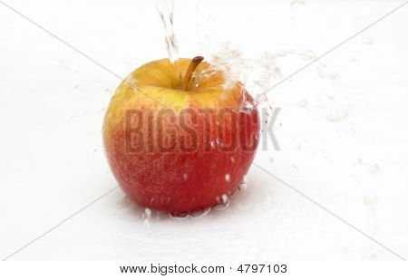 Fresh An Apple With Drops Of Water.