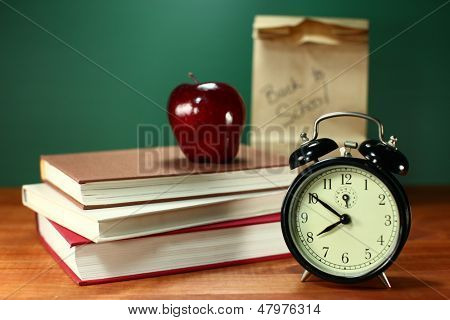 Back to School Books, Lunch, Apple and Clock on Desk