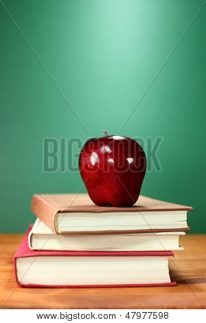 Copy Space Back to School Books and Apple With Chalkboard