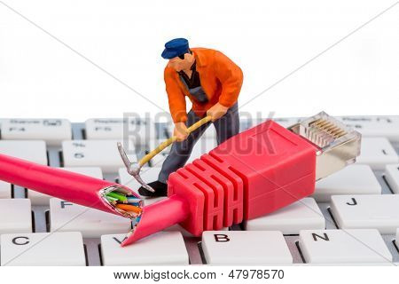 a worker repairs a network cable. symbolic photo for data security