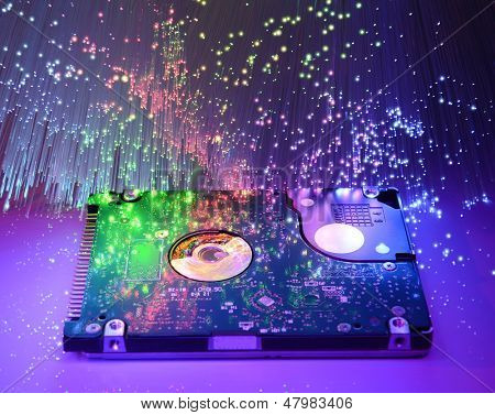 harddisk and heads on technology fiber optics background