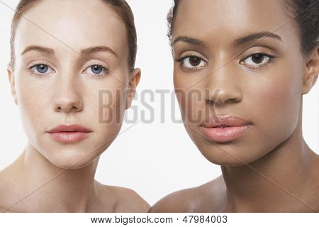 Closeup portrait of multiethnic young women isolated on white background