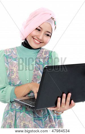 Attractive Young Woman In Head Scraf Using Laptop