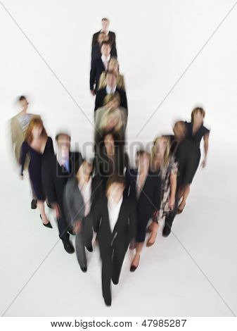 Blurred group of multiethnic businesspeople in arrow formation against white background