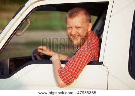 Driver In A Red Shirt While Driving