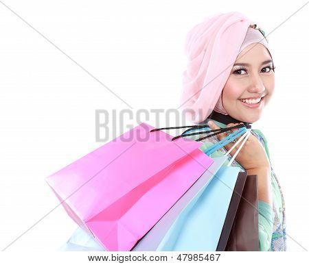 Beautiful Young Muslim Woman Holding A Few Shopping Bags