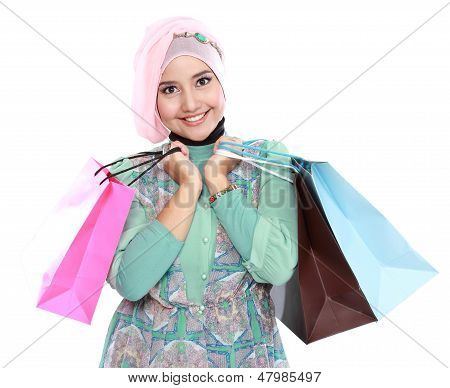 Woman In Head Scraf Holding A Few Shopping Bags