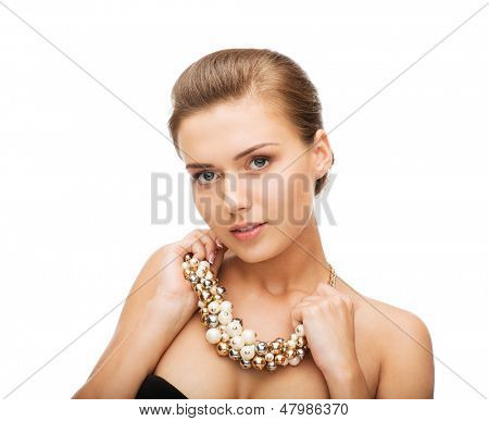 beauty and jewelery concept - beautiful woman wearing statement necklace with pearls