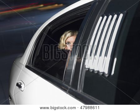 Portrait of beautiful female celebrity inside the limo car