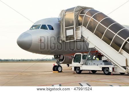 Plane with gangway on tarmac