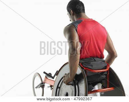 Rear view of a paraplegic cycler against white background