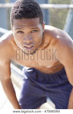 Athletic Man Leaning Over Resting