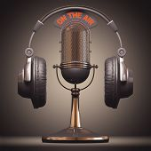 pic of microphone  - Headset on top of a classic microphone - JPG