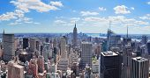 stock photo of empire state building  - New York City Manhattan midtown aerial panorama view with skyscrapers and blue sky in the day - JPG