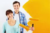 pic of wall painting  - renovation diy paint couple in new home painting wall - JPG