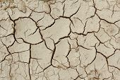 stock photo of drought  - grunge mud cracks texture dry cracked earth texture - JPG
