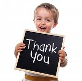picture of nursery school child  - Child holding a thank you sign standing against white background - JPG