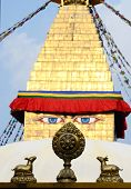 stock photo of dharma  - Buddha eyes of Bodhnath stupa and wheel of Dharma with two deers - JPG