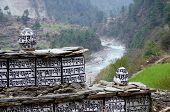 stock photo of mantra  - Buddhist mani stones with sacred mantras near Dudh Kosi river - JPG