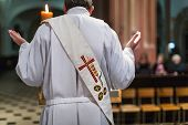 foto of eucharist  - Priest during a ceremony - JPG