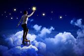 picture of ladies night  - Image of young woman lighting stars in night sky - JPG