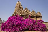 stock photo of mahadev  - Khajuraho Kandariya Mahadev Temple with flowers Western Group India - JPG