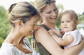 stock photo of grandmother  - Grandmother with mother and daughter against the lake - JPG