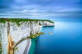 stock photo of atlantic ocean  - Etretat rock cliff and beach - JPG