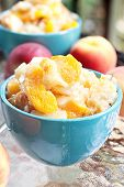 stock photo of peach  - Fresh delicious peach cobbler served in bowls outdoors - JPG