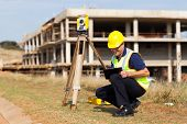 pic of land development  - middle aged land surveyor working outdoors - JPG
