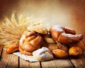 stock photo of croissant  - Bakery Bread on a Wooden Table - JPG