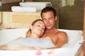 Couple Relaxing In Bubble Bath Together