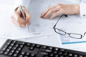 foto of fill  - picture of woman hand filling in invoice paper - JPG