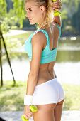 foto of spandex  - An attractive female runner stretching before her workout - JPG