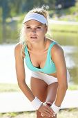 pic of spandex  - An attractive female runner stretching before her workout - JPG